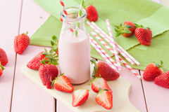 Milk with fresh strawberries royalty free stock image