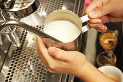 Milk  frothing from coffee making machine Stock Photography