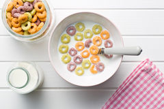 Milk with fruity cereal rings Royalty Free Stock Photos