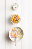 Milk with fruity cereal rings Stock Photos