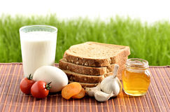 Milk, garlic, honey and egg with bread Royalty Free Stock Photos