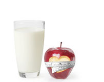 Milk in the glass and apple Royalty Free Stock Photo