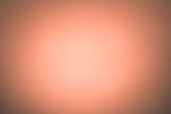 Milk glass background of fine light orange grayish orangish genu. Ine vignette centered. Fine artistic backgrounds of almost gray resulting from various rough Stock Image