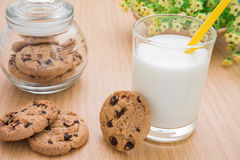 Milk glass and chocolate chip cookies Royalty Free Stock Photos