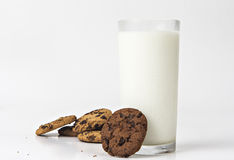 Milk glass  and cookies. On white background Royalty Free Stock Photos