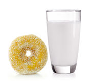 Milk in the glass and donut on white background Royalty Free Stock Photo