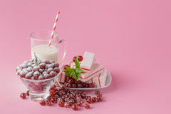Milk glass and dusted powdered sugar with cherries and mint Stock Photos