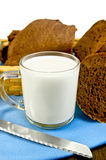 Milk in a glass goblet with rye bread Stock Images