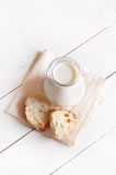 Milk in glass jug and bread Royalty Free Stock Image