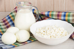 Milk in glass jug, cottage cheese and boiled eggs Stock Photos