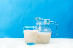 Milk in a glass jug and glass Stock Photos