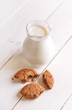 Milk in a glass jug and oatmeal cookies Stock Images