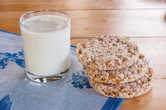 Milk in glass mug with Crispbread on wooden table. Stock Photography
