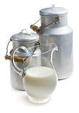 Milk in a glass pitcher. On white background Stock Photos