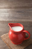 Milk in glass pitcher Stock Photo