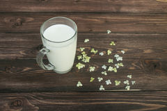 Milk in glass on table Stock Image