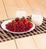 Milk with grains of a pomegranate Royalty Free Stock Image