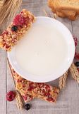 Milk and granola bar Stock Image