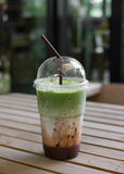 Milk green tea smoothie in plastic cup Royalty Free Stock Images