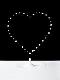 Milk heart over black Royalty Free Stock Photos