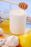 Milk with honey stock image