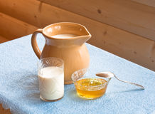 Milk and honey Royalty Free Stock Photography
