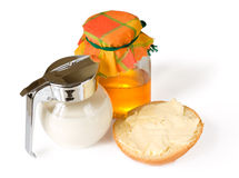 Milk, honey and bread with butter. Isolated on white with shadows Stock Image