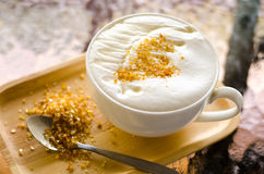 Milk honey with foam topping and sugar Royalty Free Stock Photo