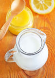 Milk and honey Stock Images