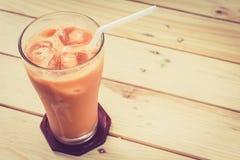 Milk ice tea on wooden table. Milk ice tea on a wooden table Stock Photos