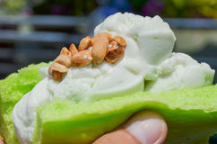 Milk icecream on pandan bread. Topping with nuts and milk Stock Images