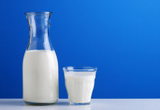 Milk in the jug. With blue sky background stock photos