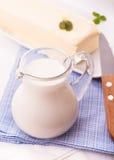 Milk jug and butter Stock Photos