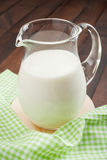 Milk jug, cottage cheese in wooden plate and sour cream Stock Images