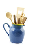 Milk jug filled with kitchen utensils Royalty Free Stock Photo