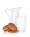 Milk jug, glass and cookies Stock Photos