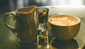 Milk jug, sugar and candies Stock Images