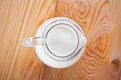 Milk in a jug on table Royalty Free Stock Image