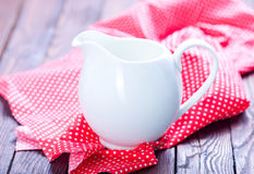 Milk in jug. And on a table royalty free stock image