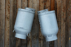 Milk Jugs. Covered with ice stock images