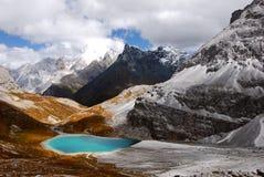 Milk lake in Sanya. The Milk lake encircled by the snow mountains. The three jokuls represents three Bodhisattvas in Tibet culture. (photo taken at Yading Royalty Free Stock Image
