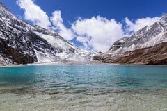 Milk lake. In the snow mountains Royalty Free Stock Photo