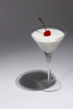 Milk Martini. A milk Martini topped with a red cherry Stock Photography