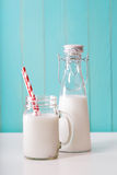 Milk in mason jar with red striped straws Stock Photography