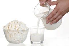 Milk, milk and hands Royalty Free Stock Photos