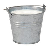 Milk in a miniature metal bucket Stock Image