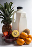 Milk and mix fruits on the white Royalty Free Stock Photography