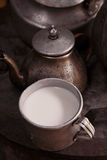 Milk mug and old teapot and kettle in a kyrgyz yurt kitchen Royalty Free Stock Image