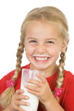 Milk mustache. Girl with milk moustache and a glass of milk royalty free stock photography