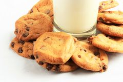 Milk `N Chocolate Chip Cookies. This is a simple composition featuring a plain glass of milk surrounded by chocolate chip cookies. The glass locates at the upper Royalty Free Stock Photography